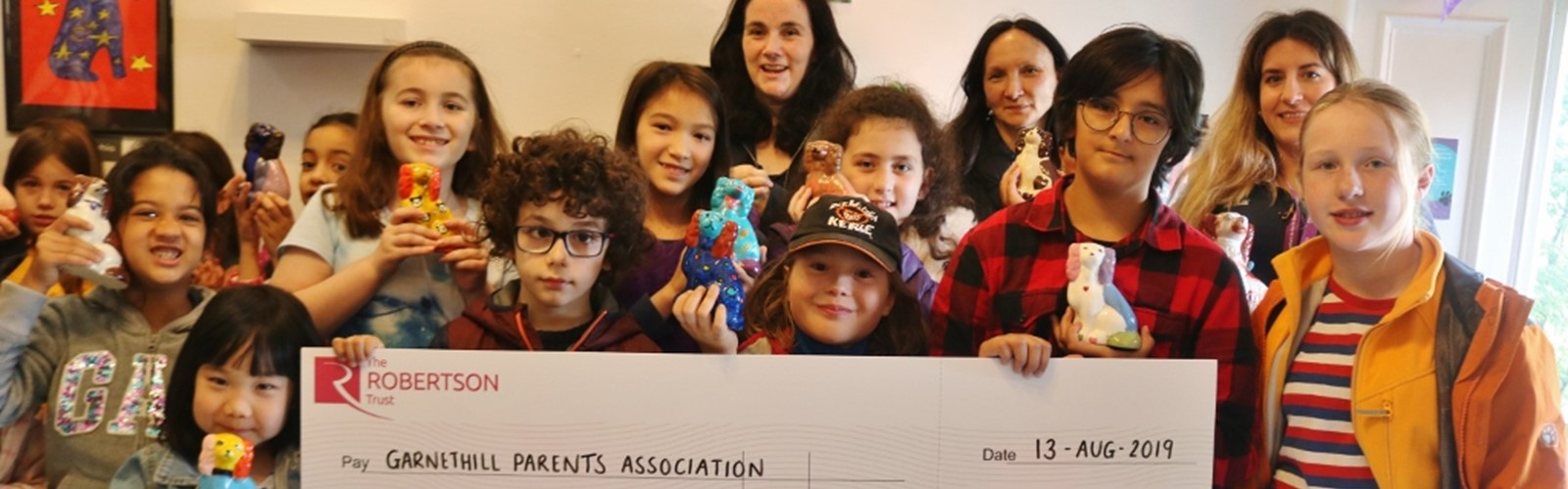 Group from Garnethill Parents Association receiving funding cheque